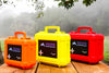 Three sizes of wilderness first aid kits designed to be carried in off road vehicles displayed on picnic table