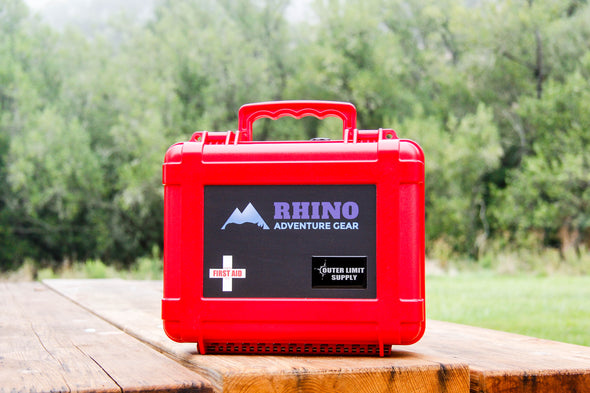 Red Emergency First Aid Kit for overland excursions with Rhino Adventure Gear logo from Outer Limit Supply