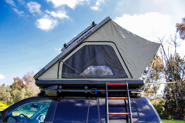 Camp King Aluminum Roof Top Tent with aluminum ladder positioned on side entrance