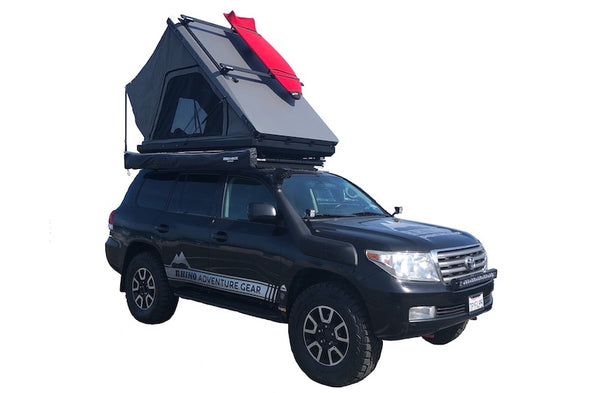 Camp King Aluminum Roof Top Tent in California with red surf board mounted to crossbars