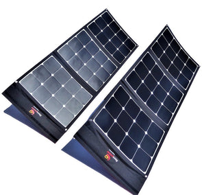 Two 100W foldable solar panels included in 200W Flexopower Baja portable solar panel kit shown deployed and angled toward the sun using integrated legs