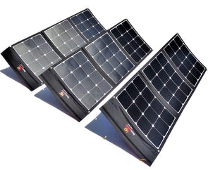 Three 100W foldable solar panels included in 300W Flexopower Baja portable solar panel kit shown deployed and angled toward the sun using integrated legs