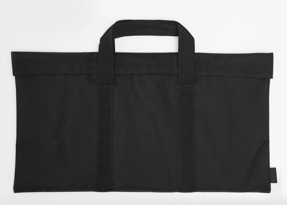 Heavy duty black carry bag custom fitted for Fold A Flame portable fire pit and grill. When stowed in bag the fire pit is less than 1 inch thick, easy to pack for camping trips