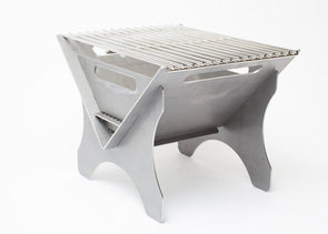 "Fold a Flame Firebug portable fire pit and grill shown fully assembled with 16"" x 12"" stainless steel cooking grill installed."