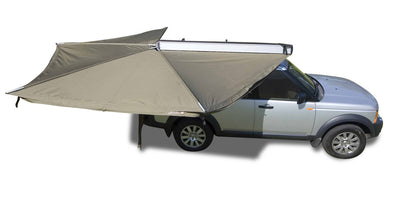 Foxwing awning shown open providing 270 degrees of shade adjacent to vehicle