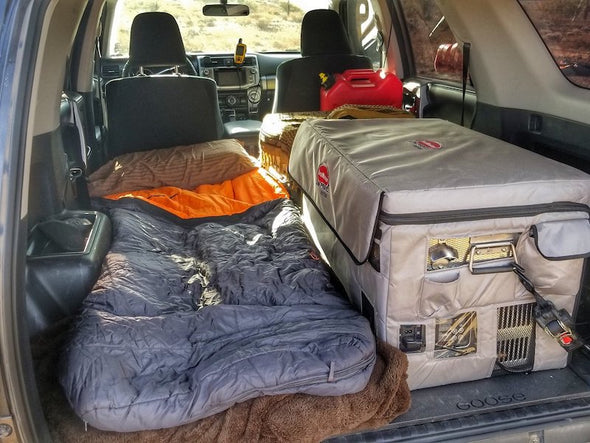 Sleeping Platforms for Toyota 4Runner in use with sleeping bag and fridge