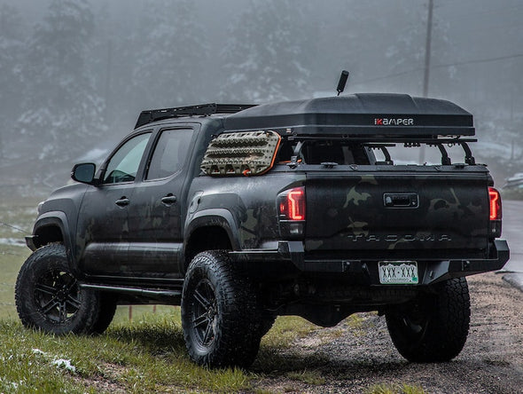 Toyota Tacoma with iKamper Mini Roof Top Tent mounted on bed rack