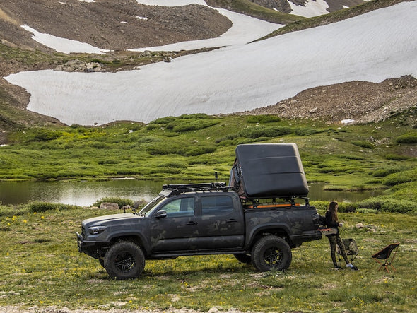 iKamper Skycamp Mini Roof Top Tent shown mounted on Tacoma bed rack - open