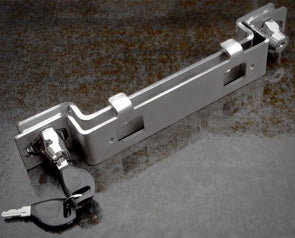 iKamper Skycamp mounting bracket lock hardware shown with key in lock