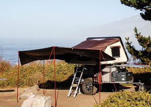iKamper Skycamp awning for roof top tent shown overlooking ocean during backcountry camping trip