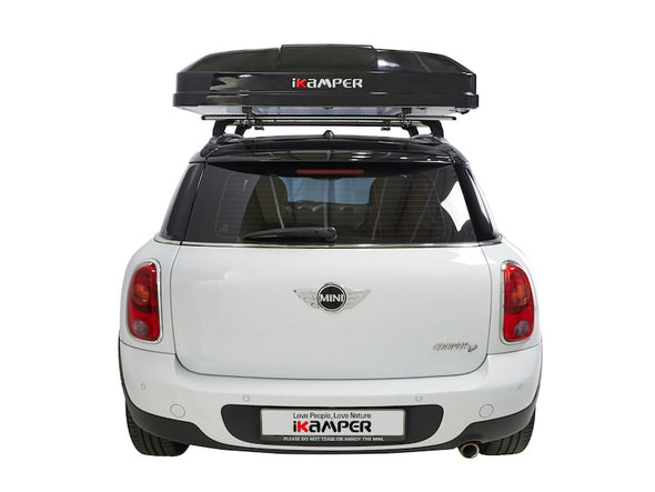 iKamper Skycamp Mini Roof Top Tent shown closes on white Mini Cooper- rear view