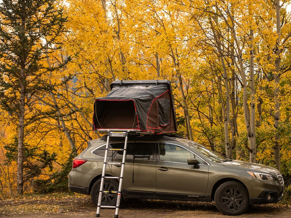 iKamper Skycamp Mini Roof Top Tent shown mounted Subaru Outback - open