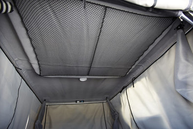 James Baroud Isothermic Kit for insulating roof top tents shown interior view of tent with inner liner attached as a second layer fabric around perimeter of roof top tent