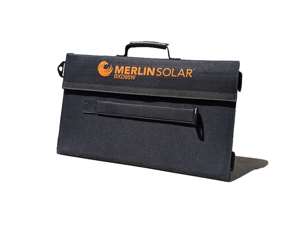 Merlin Solar BXD95 trifold portable solar panel shown folded up into thin black carry pouch