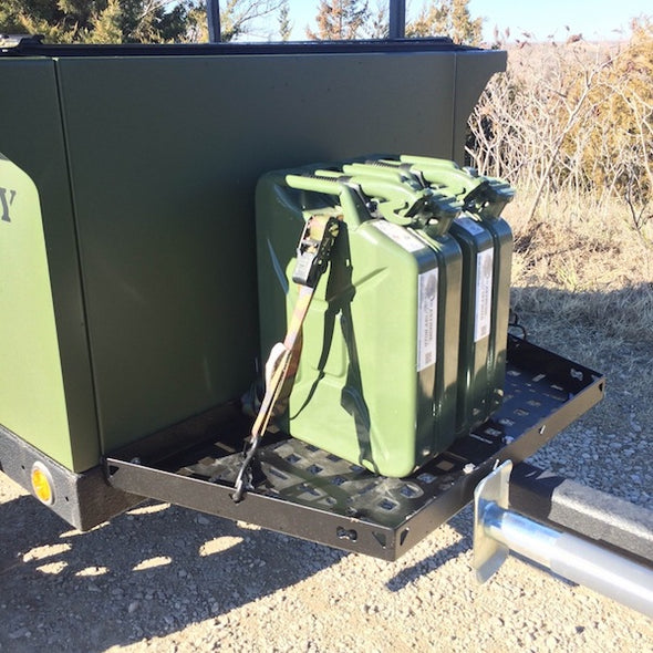 Jerry cans anchored to heavy duty front cargo deck of off road trailer
