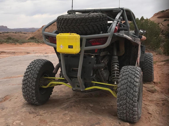 4x4 buggy with yellow weekend warrior crush proof first aid kit from outer limit supply mounted on back of buggy