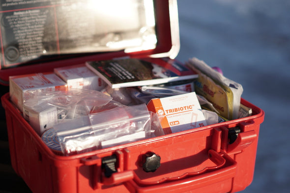 Outer Limit Supply Outback First Aid Kit case laying open to display contents
