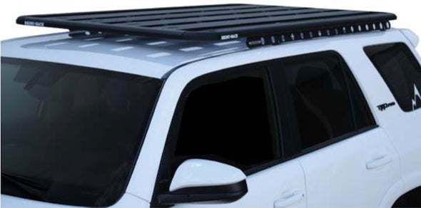 white Toyota 4Runner with Rhino Rack Backbone Mounting System and Pioneer Platform Rack System installed