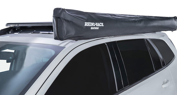 Detail of heavy black cover bag for Batwing Awning mounted on left side of vehicle roof rack