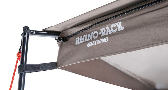 Detail of corner of Rhino Rack Batwing Awning with poles and guy lines set up
