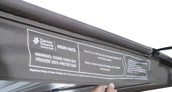 Overhanging panel of Batwing Awning with information on sun protection and supporting Cancer Council
