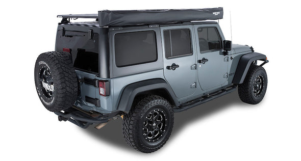 Batwing Awning mounted on passenger side of Jeep, shown packed up in black cover bag