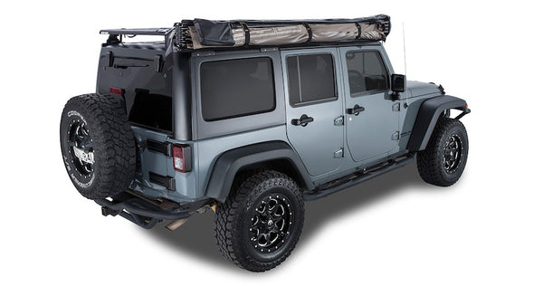 Batwing Awning mounted on passenger side of Jeep shown packed with cover bag removed