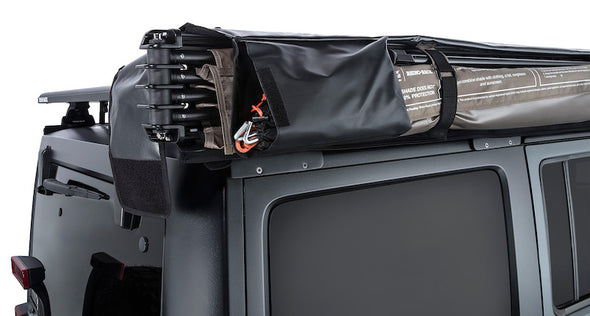 Detail of Batwing Awning storage system including velcro straps, magnetic locking legs, and velcro pouch for stakes and ropes