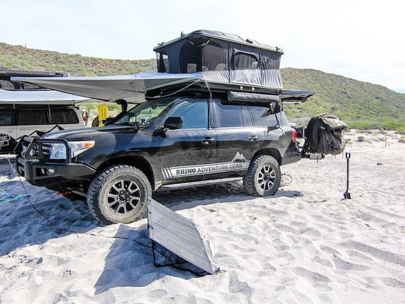 360 degree awning with roof top tent at beach campground