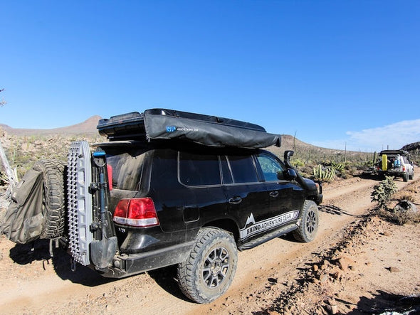 RLD GhostAwn 360 awning packed in bag mounted on roof rack