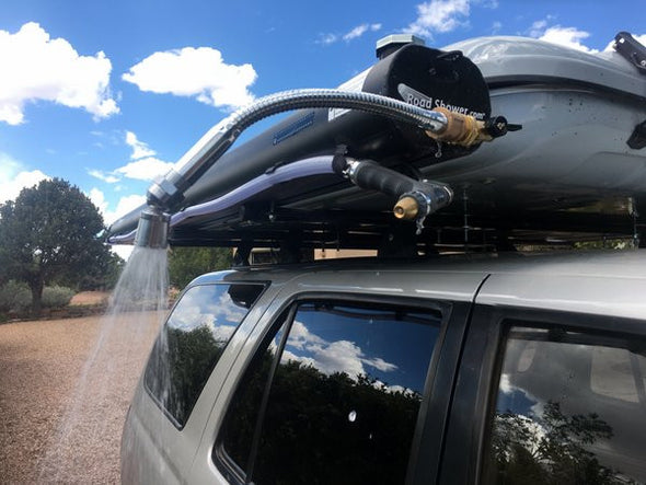 Road Shower roof rack mounted shower shown with shower nozzle spraying water