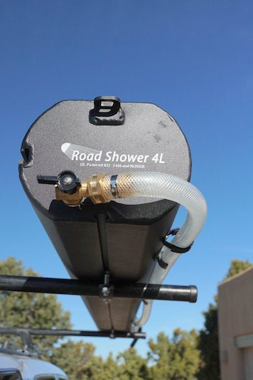 Road Shower 4L portable camping shower shown mounted on roof rack