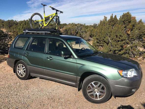Off road subaru equipped with Road Shower 4S shower on vehicle roof rack