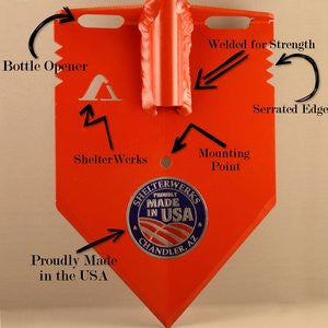 Shelterwerks shovel blade annotated image labelling functions of various features of MPS-2T shovels including bottle opener, serrated edge, mounting point, Shelterwerks logo, and USA-manufacturing sticker