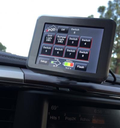 sPOD bantam 8 circuit system with touchscreen display control module mounted on vehicle dashboard