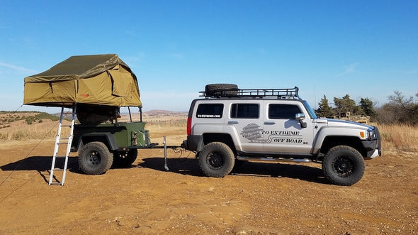To Extreme Off Road Trailer shown with Roof Top Tent mounted on elevated Rack System