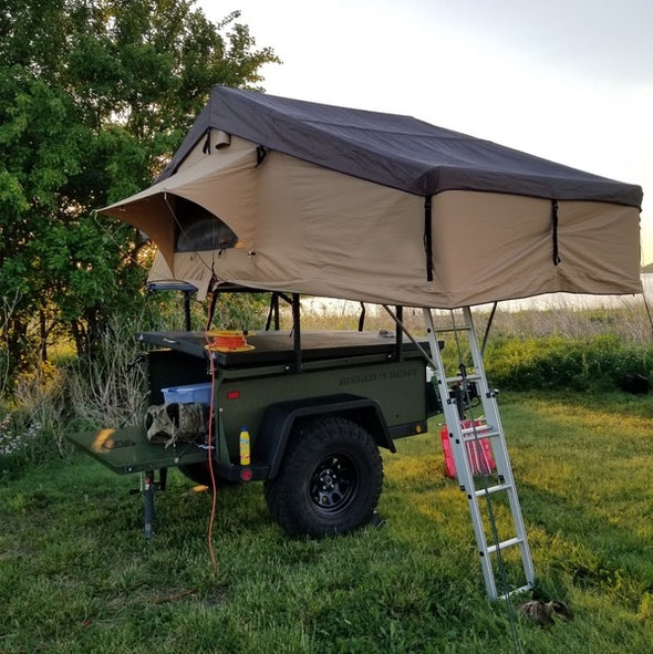 Roof Top Tent on To Extreme Rugged and Ready Off Road Trailer set up at grassy base camp