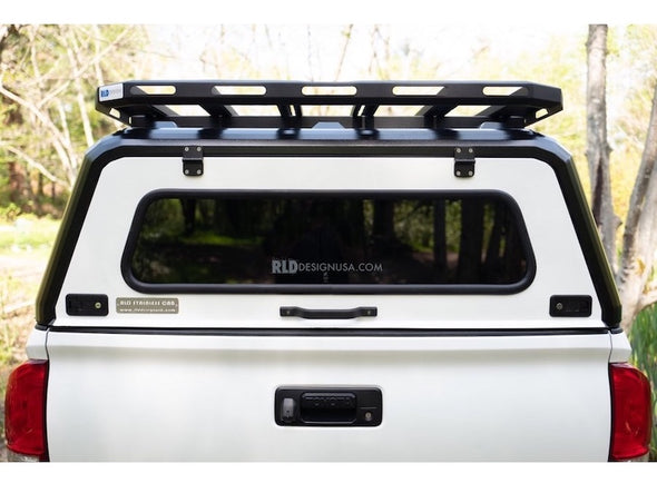 Rear window of RLD Stainless steel truck cap on Toyota Tacoma