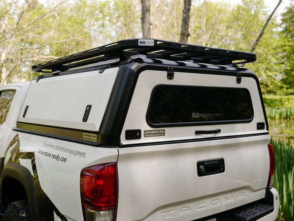 RLD Design stainless Steel Canopy for 3rd Gen Toyota Tacoma shown with white doors