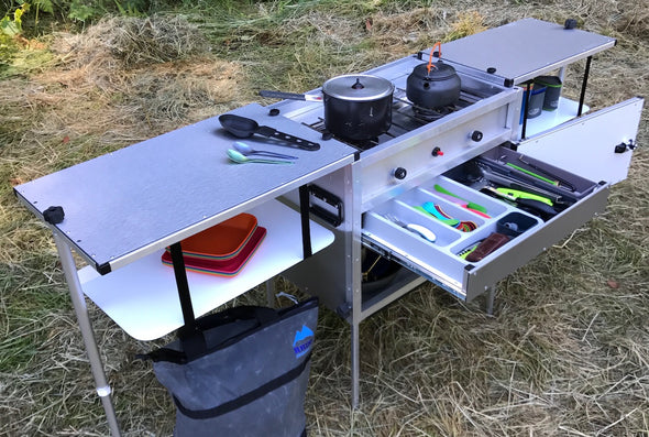 Trail Kitchens Camp Kitchen with Integrated Stove set up outdoors with utensil drawer open and pots on the stove