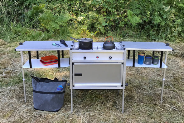 brushed stainless steel Trail Kitchens Camp Kitchen with Integrated Stove set up outdoors