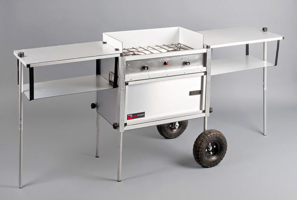 Trail Kitchen Camp Kitchen with Integrated Stove shown fully assembled with wheels for easily fine tuning your kitchen location