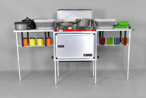 Trail Kitchens Camp Kitchen shown assembled with cookware and dinnerware on shelves