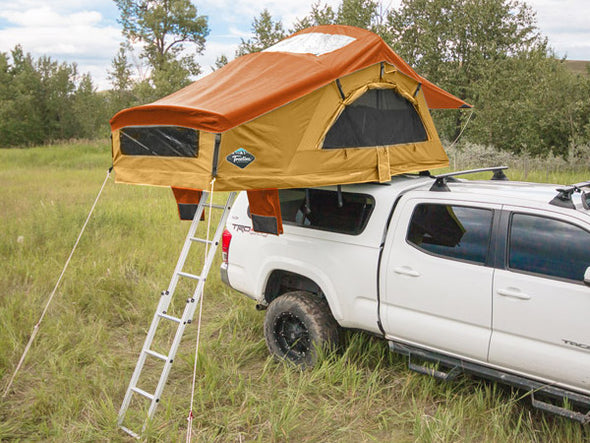 Buckskin Treeline ponderosa constellation roof top tent on truck topper with orange rainfly