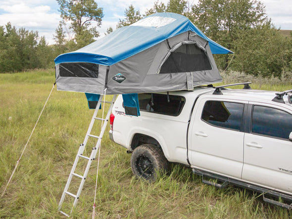 Grey Treeline Tamarack Constellation roof top tent on truck topper with blue rainfly