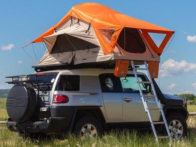 Treeline Outdoors Joshua Mojave Soft Shell Roof Top Tent shown with Burnt Orange Rainfly
