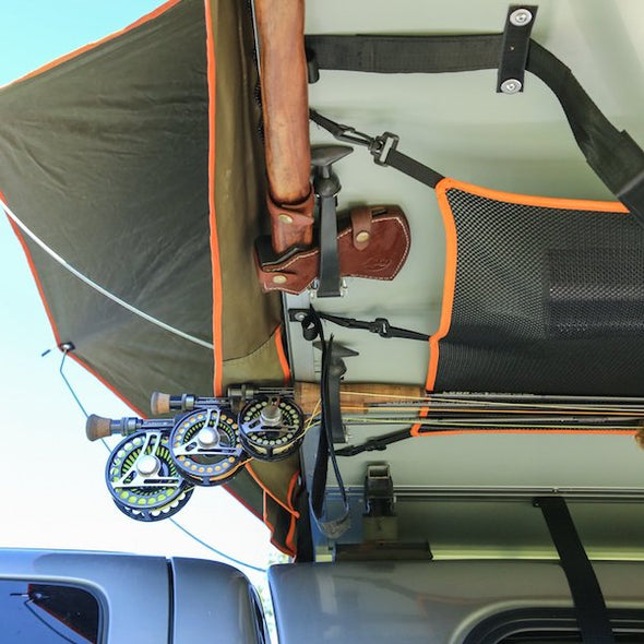 Cargo net and utility strap storage features under floor of Treeline Roof Top Tent