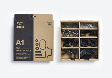 Ubco 2x2 Adapter Pack showing inside and outside of product packaging. The inside of the box is divided into 8 compartments to organize the various nuts, bolts, washers, L-brackets, and tube adapters that comprise the 2x2 Adapter Pack