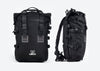 Two black Ubco Pannier Backpacks, one viewed from the front and the other viewed from the side. Backpacks have heavy-duty tactical appearance with thick straps and buckles to secure roll top flap.