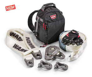 Warn Epic Recovery Kit components including tree trunk protector, epic snatch block, shackles, recovery strap, kevlar gloves and a recovery damper backpack